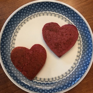 Cocoa beet heart pancakes on a plate.
