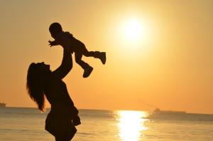 Mom with child in sunset